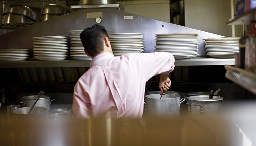 Worker in restaurant kitchen