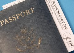 Passport with COVID Vaccination sheet
