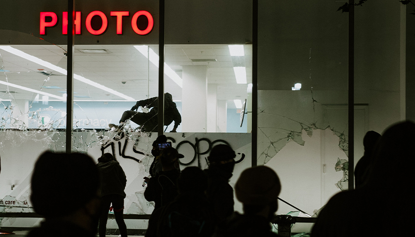 People looting Walgreens at night