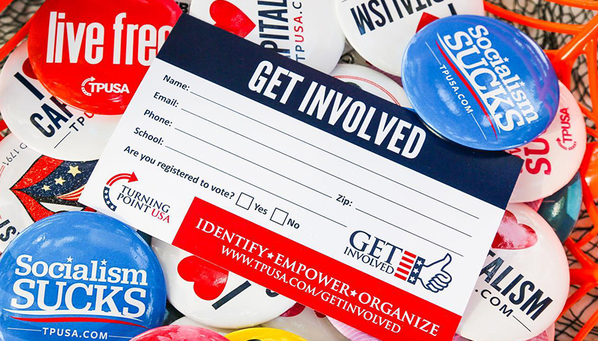 """Assortment of conservative buttons with a """"Get Involved"""" Turning Point USA fillout"""