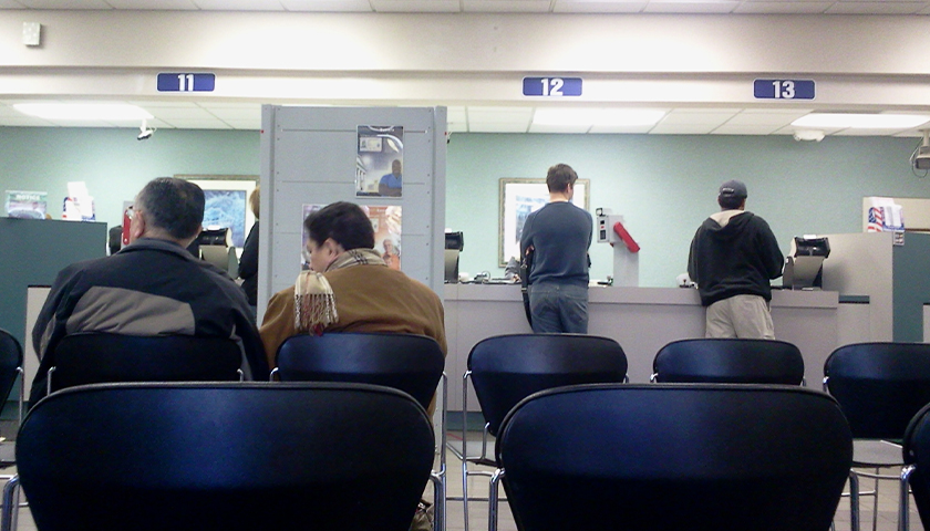 People in chairs at the DMV