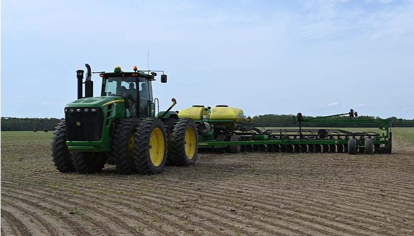 Farmer on a tractor, tilling field