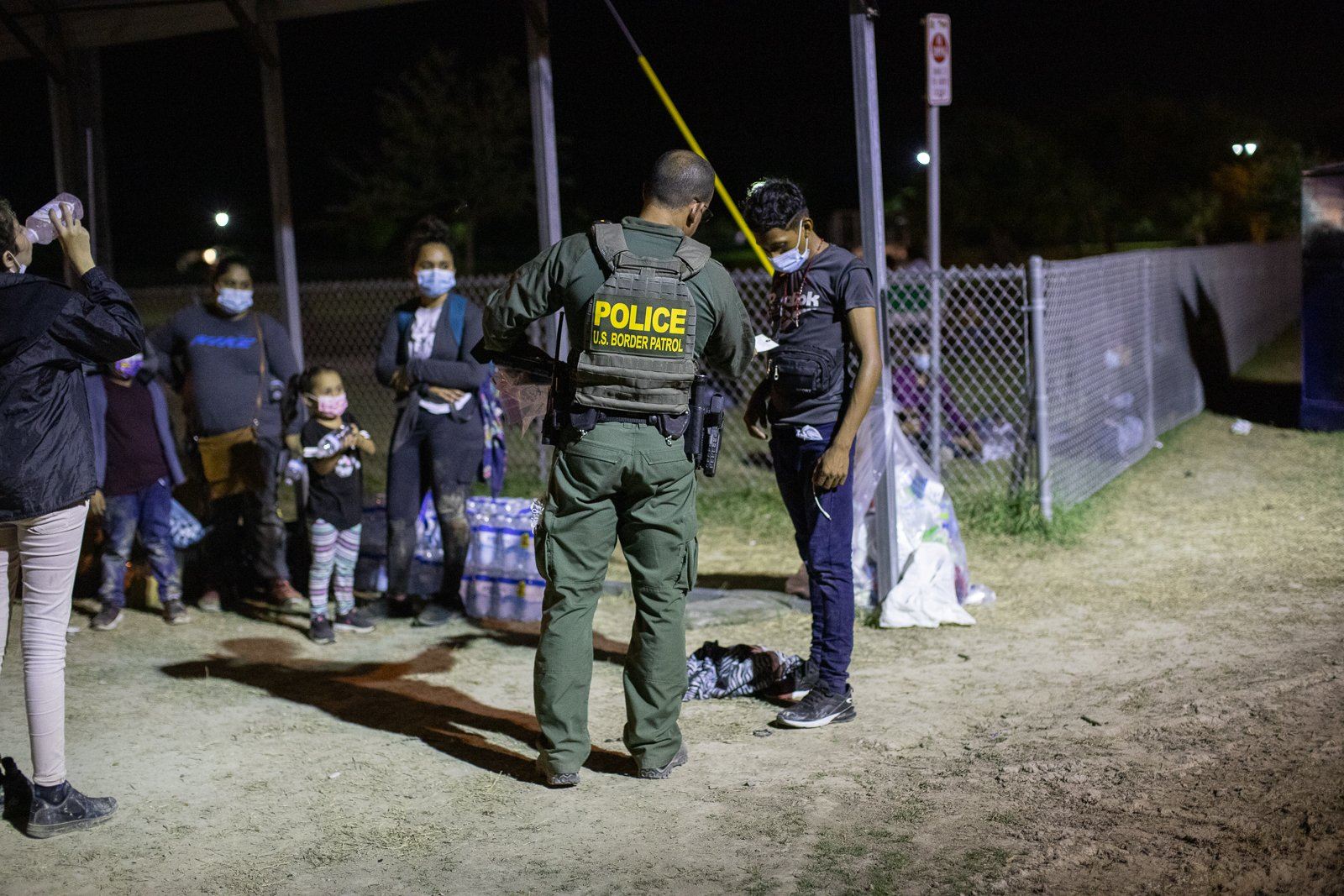 Some migrants traveling in a group consisting of only men attempted to avoid law enforcement officials after illegally entering the U.S. by running into bushes told Border Patrol agents they were 17 years old after they were apprehended near La Joya, Texas on August 7, 2021. (Kaylee Greenlee – Daily Caller News Foundation)