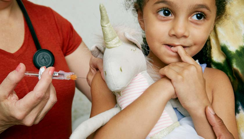 Young girl getting COVID vaccination