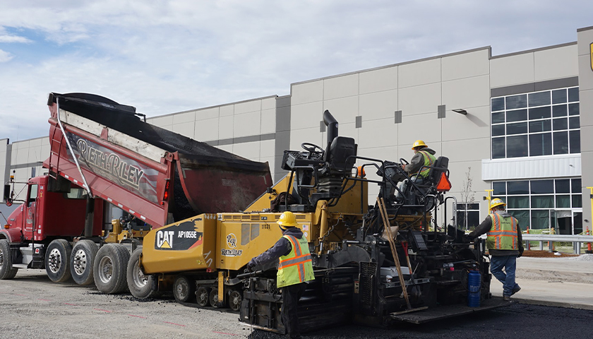 Rieth-Riley Construction paving a parking lot