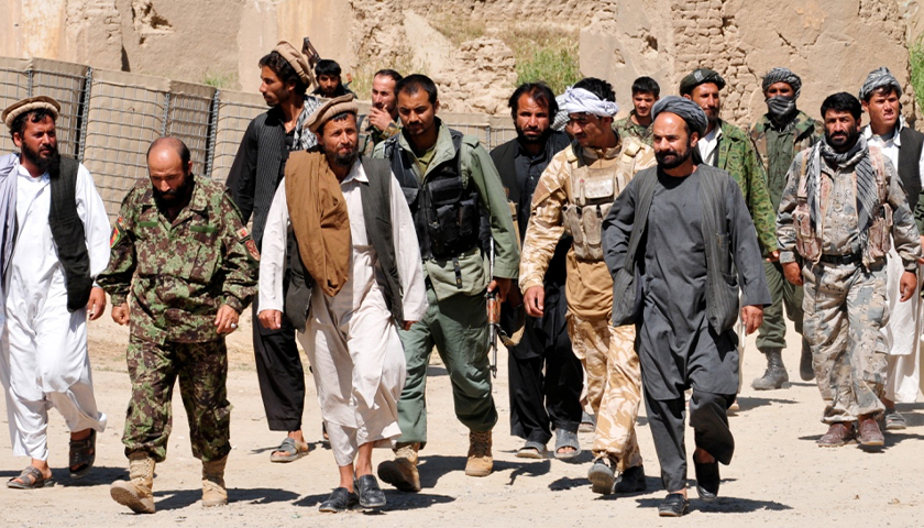 Taliban insurgents turn themselves in to Afghan National Security Forces at a forward operating base in Puza-i-Eshan