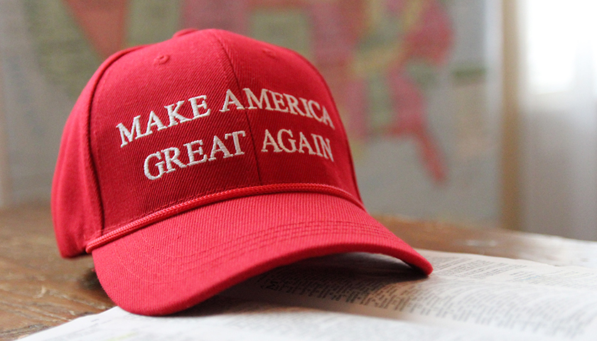 Make America Great Again hat on table