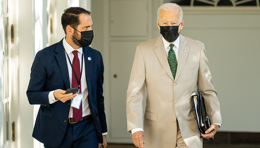 President Joe Biden and Personal Aide Stephen Goepfert walk through the Colonnade, Friday, August 6, 2021, on the way to the Oval Office of the White House. (Official White House Photo by Adam Schultz)